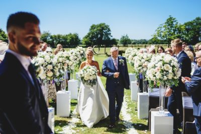 civil ceremony outside with rose pedestals at Southwood Hall Norfolk